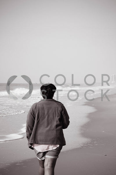 Woman walking on beach - Colorstock™  © Tee Dubose  - diverse stock photos