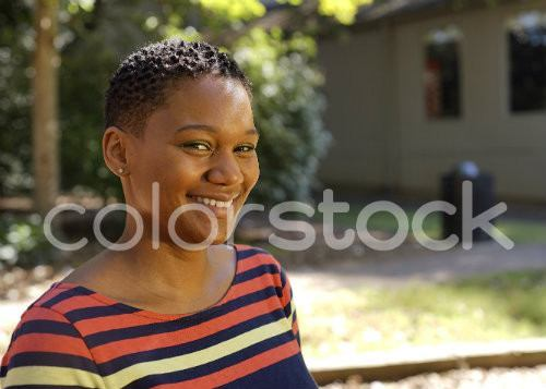 Woman with short hair looking at camera smiling - Colorstock™  © David Huff  - diverse stock photos