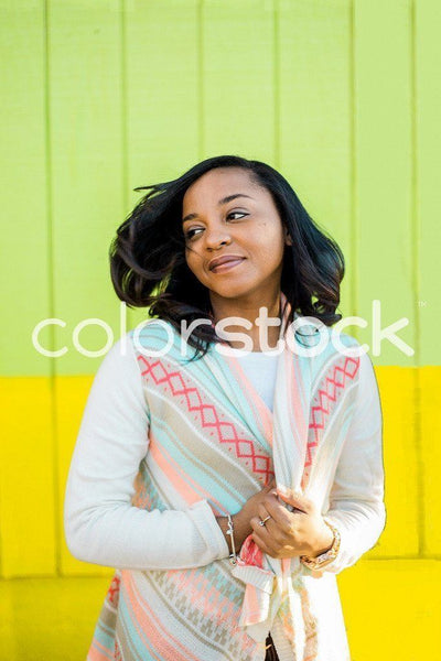 Woman with wind blowing in her hair - Colorstock™  © Latoya Dixon  - diverse stock photos
