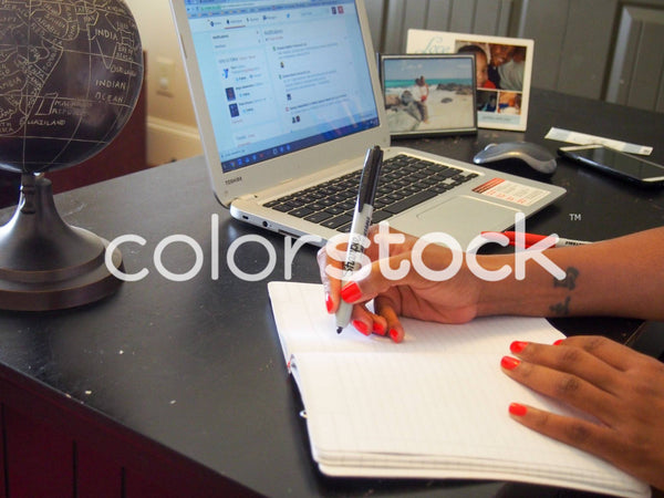 Woman writing in sketchbook - Colorstock™  © Jenifer Daniels  - diverse stock photos