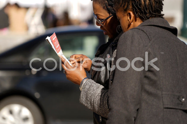 Women looking at a map - Colorstock™  © David Huff  - diverse stock photos