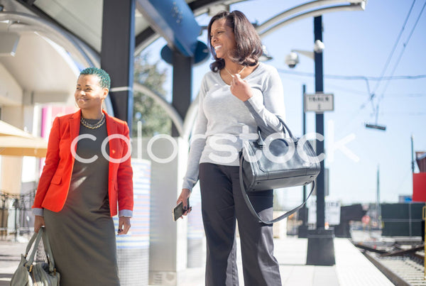Women waiting for train in city - Colorstock™  © Shea Parikh  - diverse stock photos