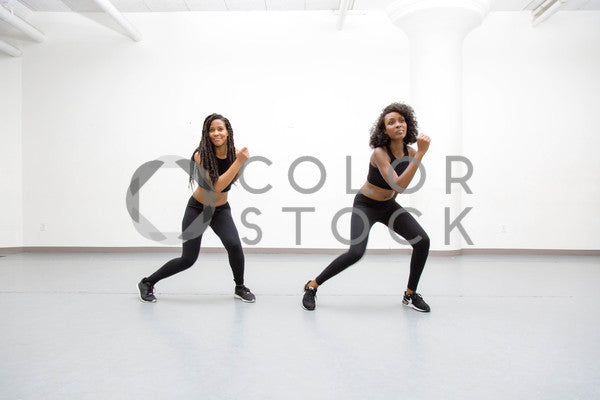 Two women in dance class - routine 3 - Colorstock™  © Click Clique NYC  - diverse stock photos