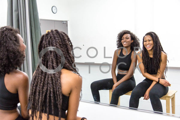 Two women in dance class - in the mirror laughing - Colorstock™  © Click Clique NYC  - diverse stock photos