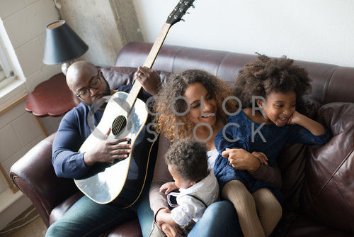 Family relaxing on couch with guitar, Some Sweet Photography - Colorstock: diverse stock photos