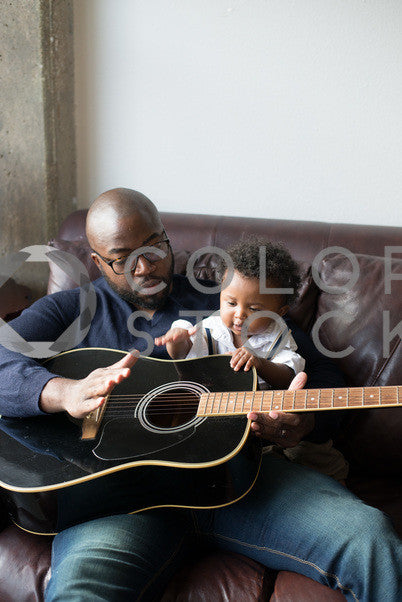 Father and son on the couch, Some Sweet Photography - Colorstock: diverse stock photos
