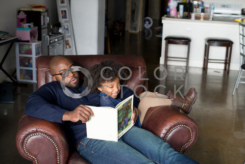 Dad and daughter on couch reading, Some Sweet Photography - Colorstock: diverse stock photos