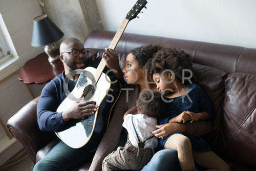 Family relaxing on couch, Some Sweet Photography - Colorstock: diverse stock photos