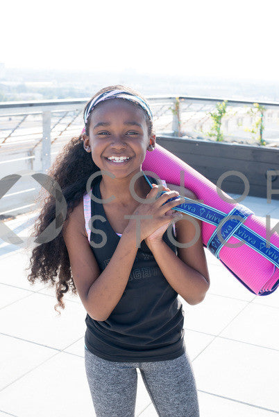 Kid with pink yoga mat, Some Sweet Photography - Colorstock: diverse stock photos