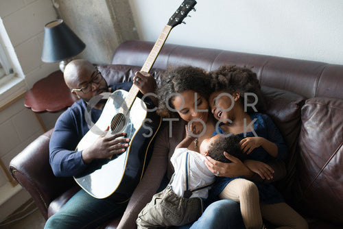 Family relaxing on couch and enjoying each other's company, Some Sweet Photography - Colorstock: diverse stock photos