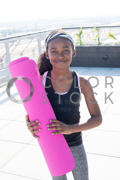 Kid holding yoga mat