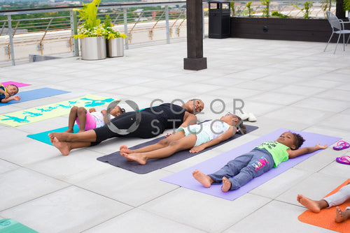 Children doing yoga with instructor, Some Sweet Photography - Colorstock: diverse stock photos