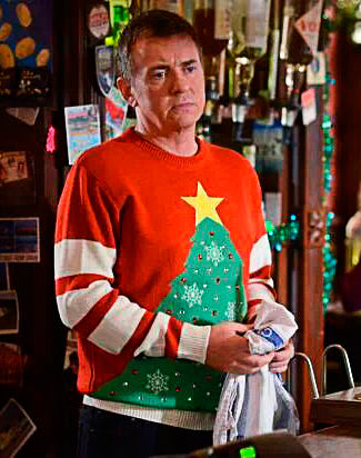 Alfie Moon wearing a Christmas Jumper