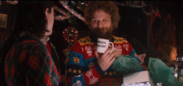 Seth Rogen wearing a Christmas sweater
