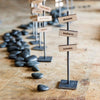 steel desktop stands with zen rocks decorated with magnetic intention blocks