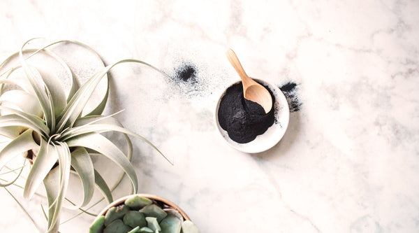 Shrink your pores with Activated Charcoal! Learn more about the amazing benefits of Activated Charcoal for your skin on the SpaGoddess Blog.