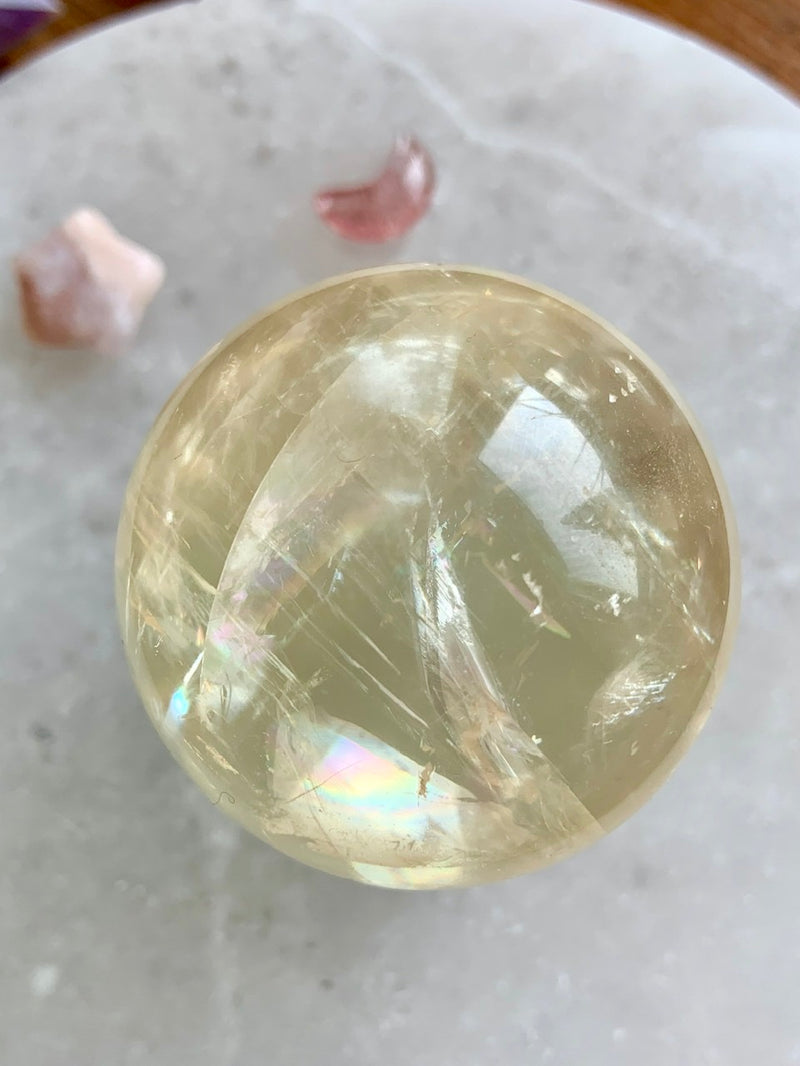 Remarkably Clear RAINBOW HONEY CALCITE Sphere with clear glass stand, # 10