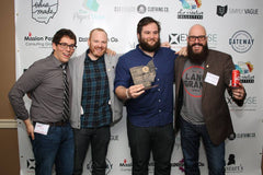 The Land Grant Brewing crew shows off their Ohio Made Award