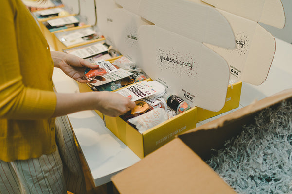 Putting together our mail order care packages for long distance birthdays, cheer ups, and more