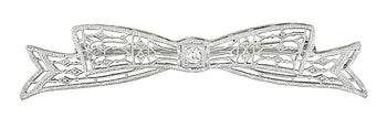Antique 1920's Art Deco Diamond Set Engraved Filigree Bow Brooch in 14 Karat White Gold