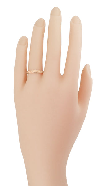 R209R Rose Gold Vintage Wedding Band on a Womans Hand (Pink Gold)