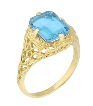 Art Deco Flowers and Leaves Swiss Blue Topaz Filigree Ring in 14 Karat Yellow Gold - December Birthstone