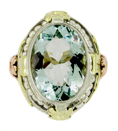 Art Deco Filigree Aquamarine Estate Ring Framed with Seed Pearls in 14 Karat Tricolor Gold