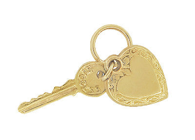 Puffed Heart and Key to Success and Love Vintage Charm in 14 Karat Yellow Gold - Item: C664 - Image: 1