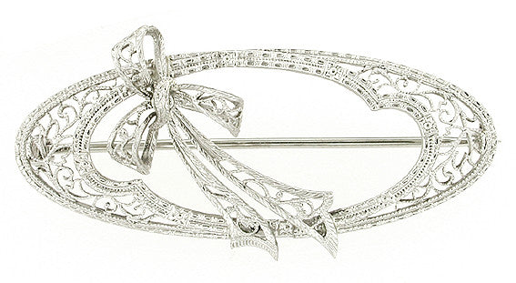 Edwardian Oval Shaped Heirloom Filigree Bow Brooch in 14 Karat White Gold