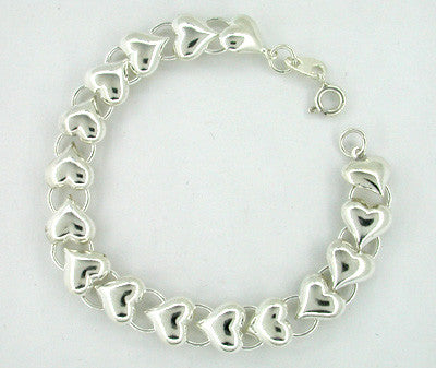 Linked Hearts Charm Bracelet in Sterling Silver