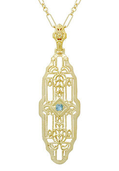 1920's Art Deco Filigree Sky Blue Topaz Necklace in Yellow Gold Over Sterling Silver