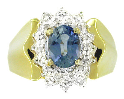 Oval Sapphire and Diamonds Estate Ring in 14 Karat Gold