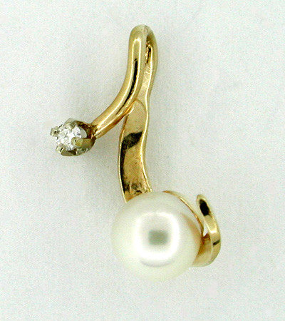 Pearl and Diamond Free Form Pendant in 14 Karat Gold