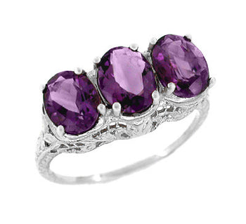 Edwardian Three Stone Oval Amethyst Filigree Ring in 14 Karat White Gold