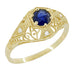 Edwardian Blue Sapphire and Diamonds Scroll Dome Filigree Engagement Ring in 14 Karat Yellow Gold