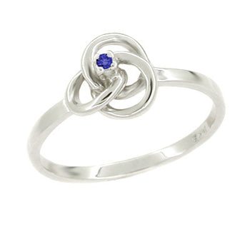 Blue Sapphire Love Knot Ring in 14 Karat White Gold
