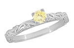 Art Deco Scrolls Fancy Yellow Diamond Engagement Ring in 14 Karat White Gold