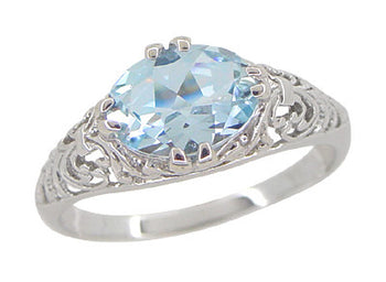 Edwardian Oval Sky Blue Topaz Filigree Engagement Ring in 14 Karat White Gold