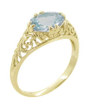 Edwardian Oval Aquamarine Filigree Ring in 14 Karat Yellow Gold
