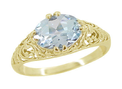 Edwardian Oval Aquamarine Filigree Ring in 14 Karat Yellow Gold - Item: R799YA - Image: 1
