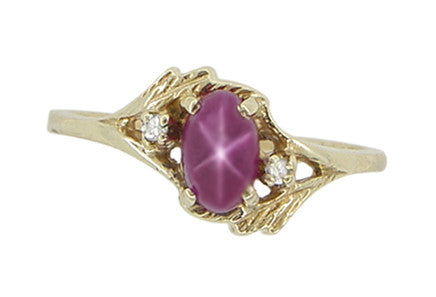 Star Ruby and Diamonds Twist Estate Ring in 10 Karat Gold - Item: R921 - Image: 1