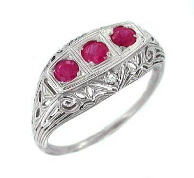 Three Stone Ruby and Diamonds Filigree Ring in 14 Karat White Gold