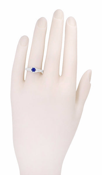 R149 - Hand Photo of Filigree Sapphire and Diamond Engagement Ring