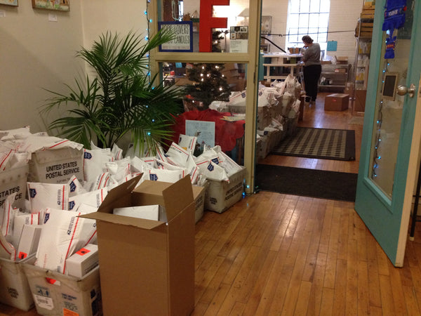 Piles of holiday orders ready for pickup