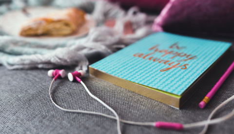 book and headphones
