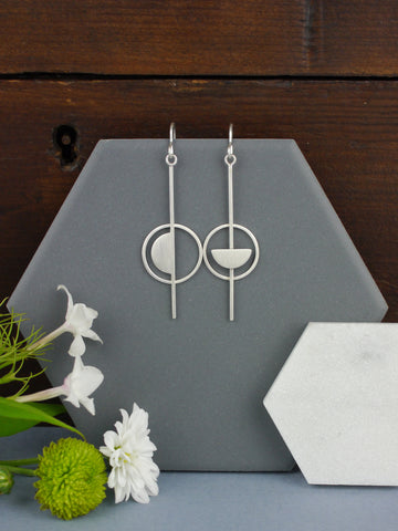 long-silver-asymmetrical-statement-silver-dangly-earrings