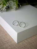 large silver geometric circle statement stud earrings