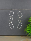 long-geometric-statement-silver-earrings