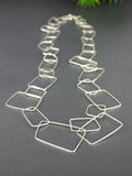 very-long-silver-rectangular-geometric-statement-necklace
