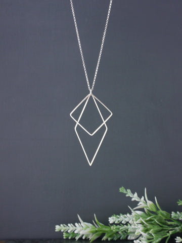 long-statement-geometric-square-diamond-silver-pendant